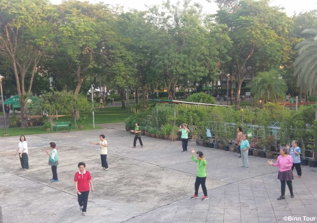 group of women exercising at Rommaninat Park in the morning