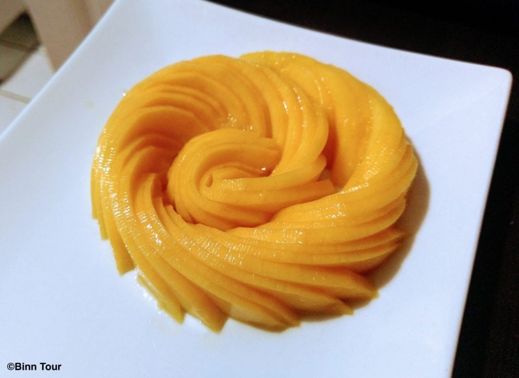 Thin slices of mango arranged to form a circle