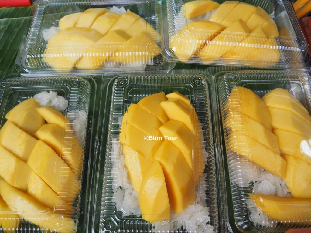 boxes of mango with sticky rice sold on the street
