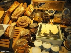 breakfast spread at Kempinski hotel with a variety of bread