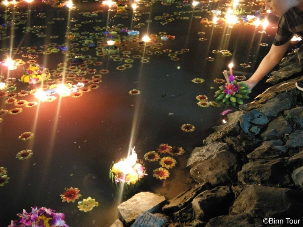Krathongs floating in a pond