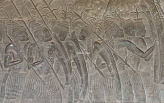 wall relief showing a military procession