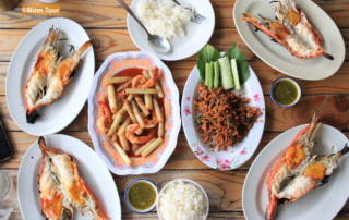 dining table with lots of Thai dishes